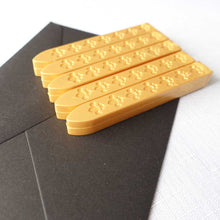 5 pack of wickless wax sticks for wax seals in a yellow gold metallic colour