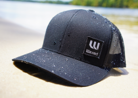 Waxed Yupoong Black Retro Trucker Snapback