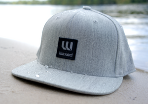 Waxed FlexFit 110 Heather Grey Flat Bill Snapback