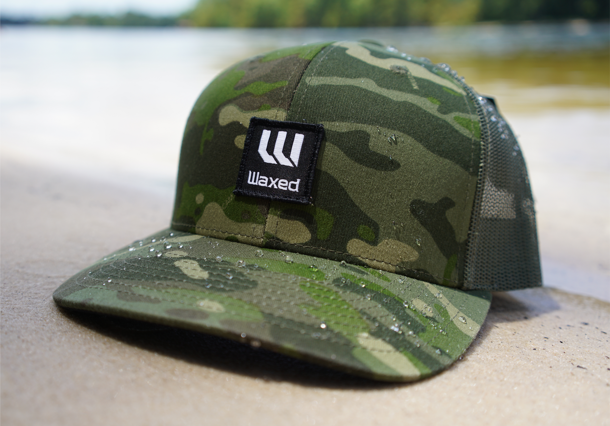 Waxed Yupoong Multicam Tropic Retro Trucker Snapback