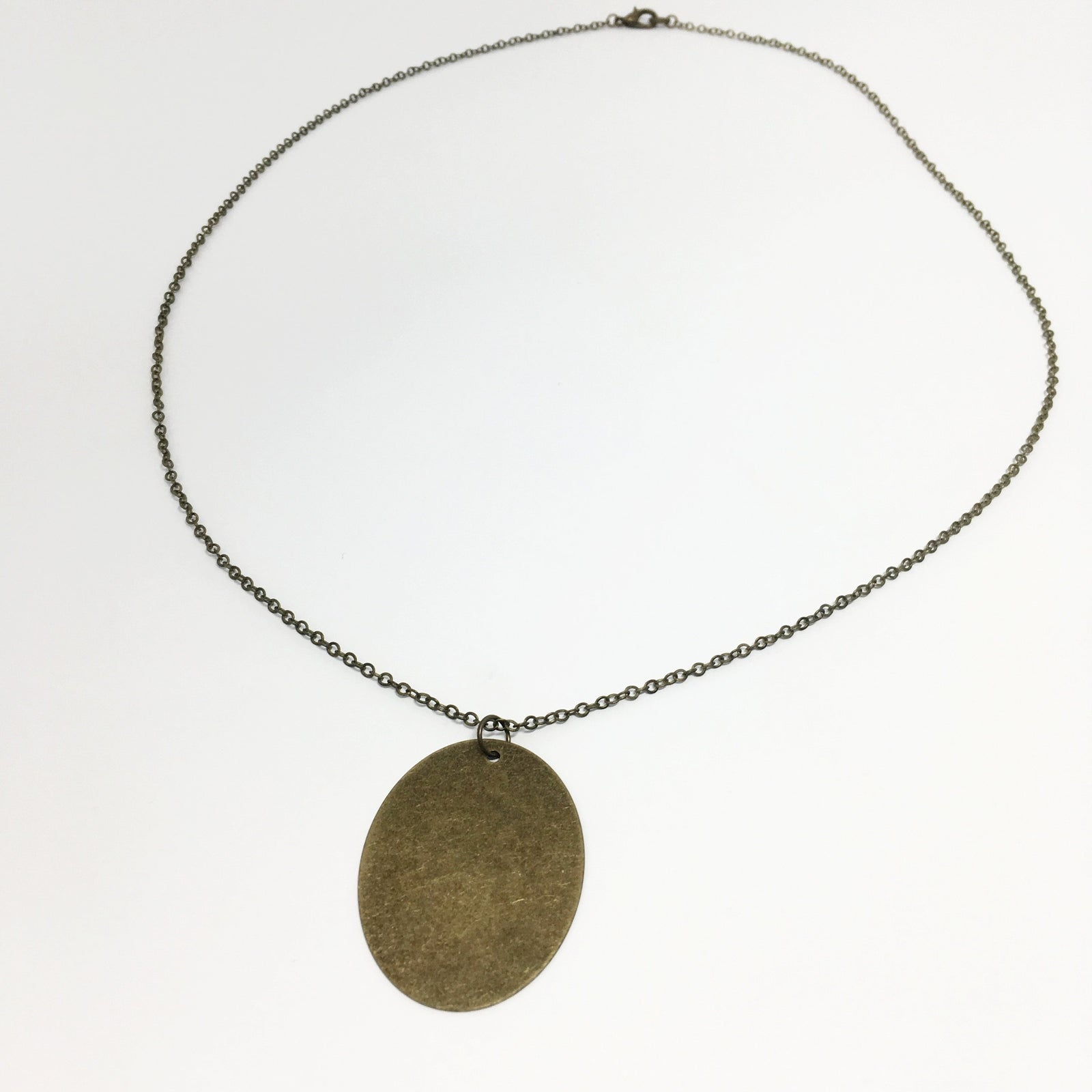 OVAL BRONZE DISK NECKLACE