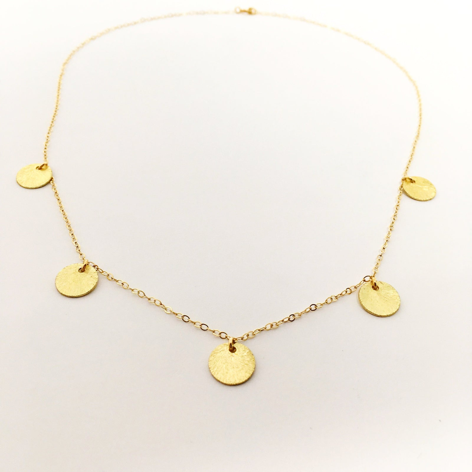 14K FEATHERED DISK GOLD NECKLACE