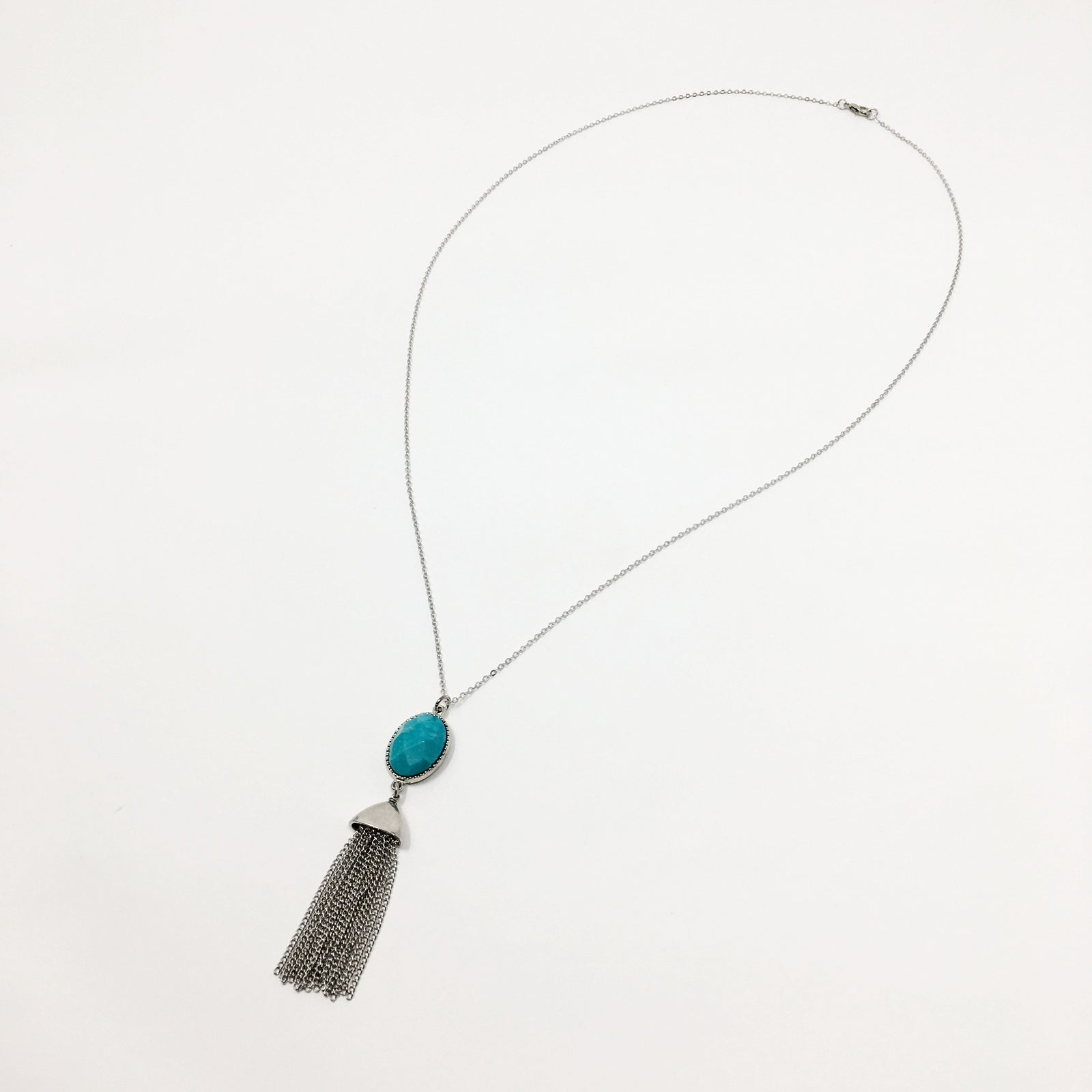 TURQUOISE HOWLITE AND SILVER CHAIN TASSEL NECKLACE