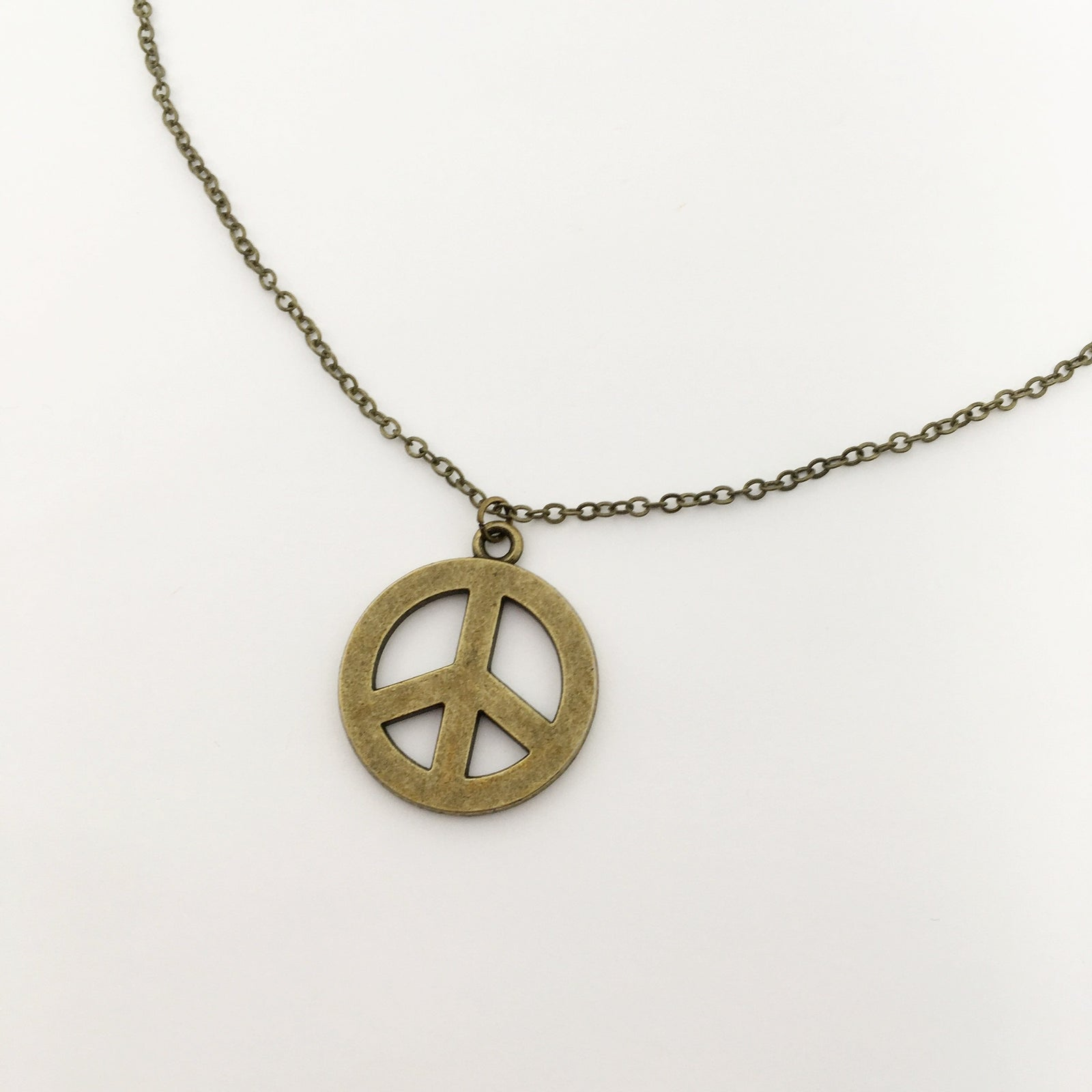 LARGE PEACE NECKLACE | BRONZE