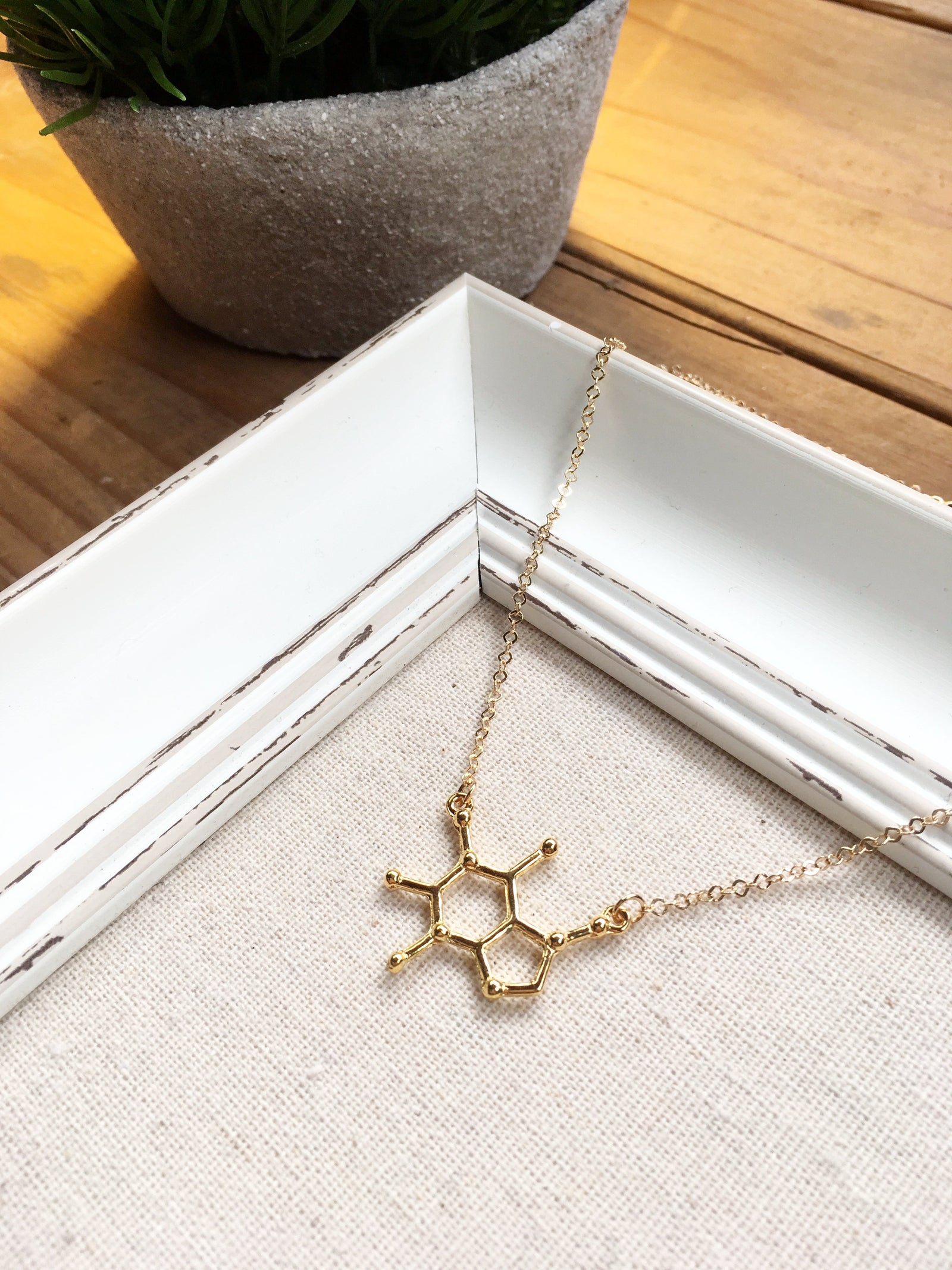 GOLDEN CAFFEINE MOLECULE NECKLACE