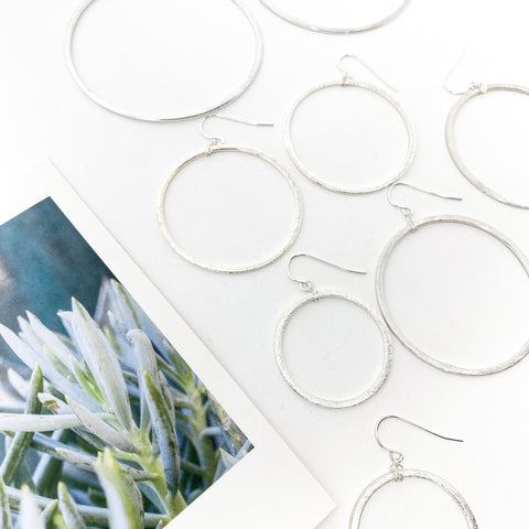 BRUSHED FLORAL CIRCLE EARRINGS | STERLING SILVER