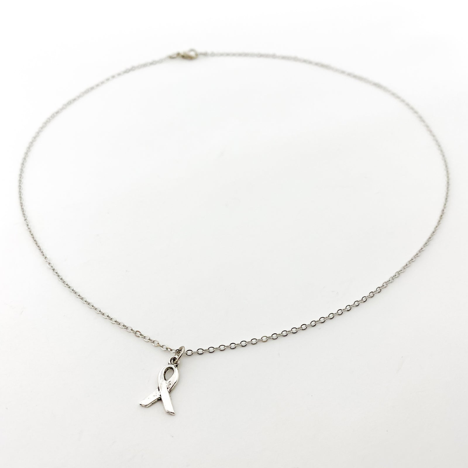 AWARENESS RIBBON NECKLACE | SILVER