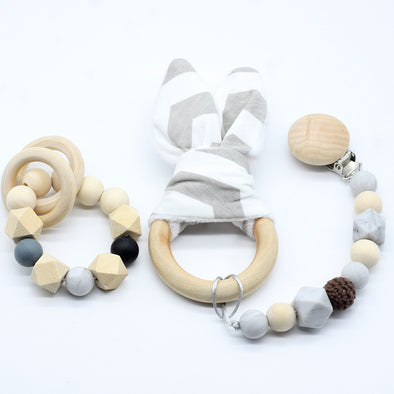 3 piece set of teething bracelets and pacifier clip