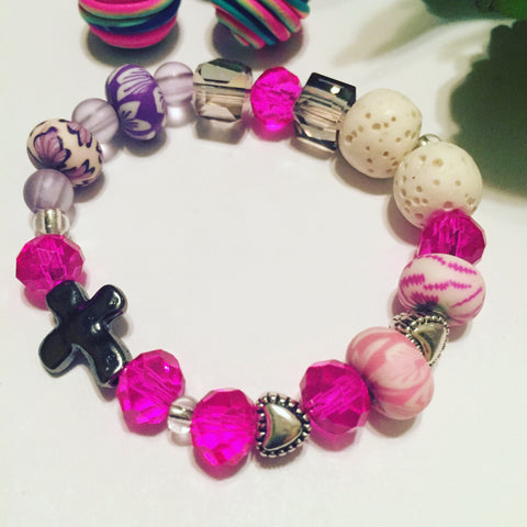Children's pink lava stone diffuser bracelet fire and ice crystals and faith cross charm