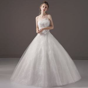 Strapless Asymmetrical Neckline Over Lace Tulle Wedding Gown