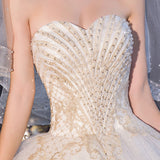 Sweetheart Beaded Tulle Overlay Bridal Gown