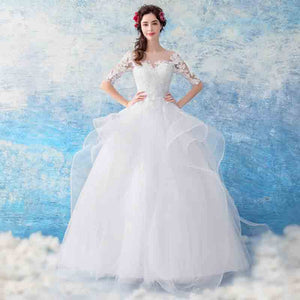 Sheer Neck Half Sleeves Ruffles Tiered Skirt Wedding Gown