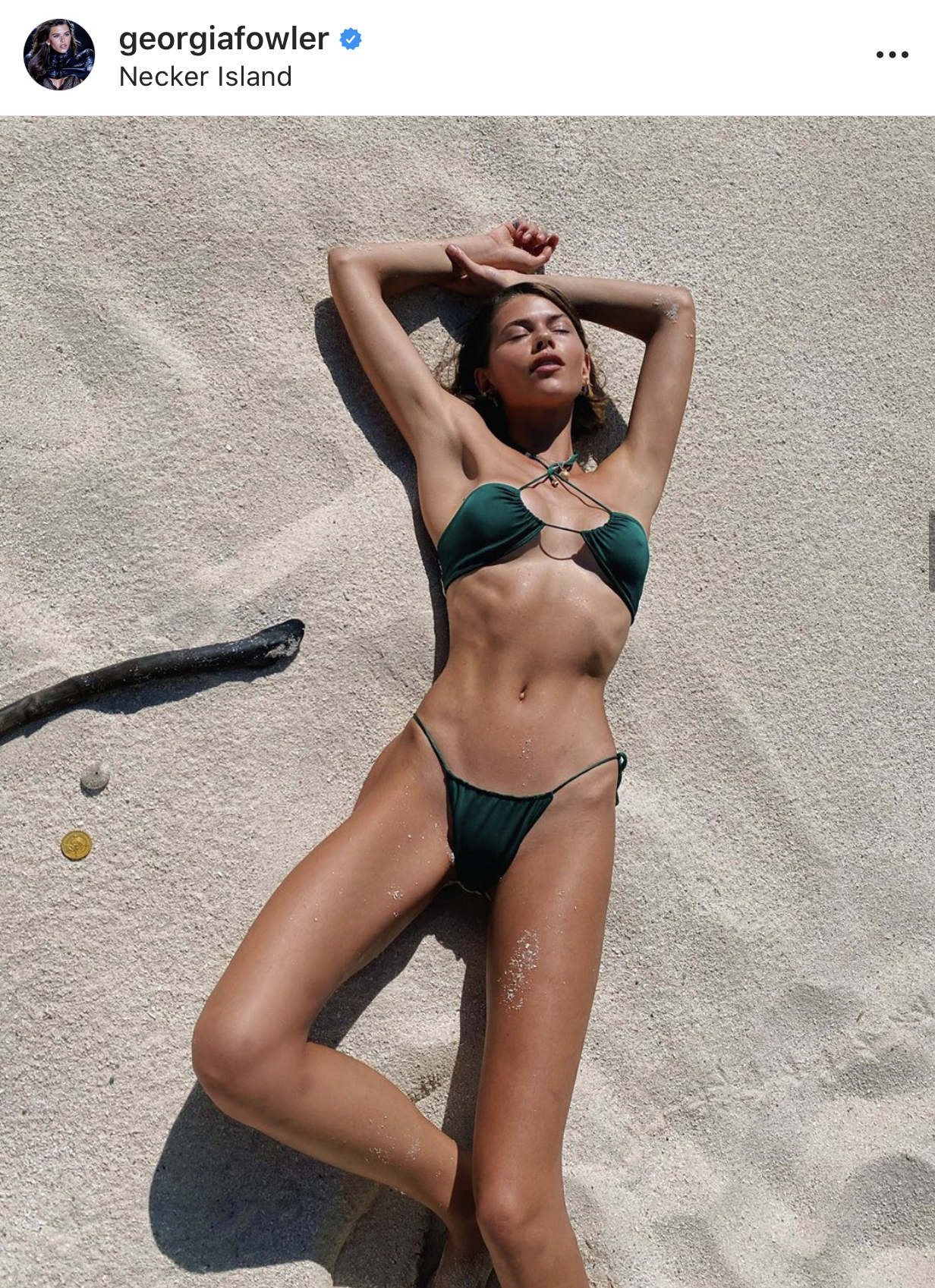 Supermodel Georgia Fowler sun baking in the Xena Halter Bikini Top in Emerald by Sommer Swim