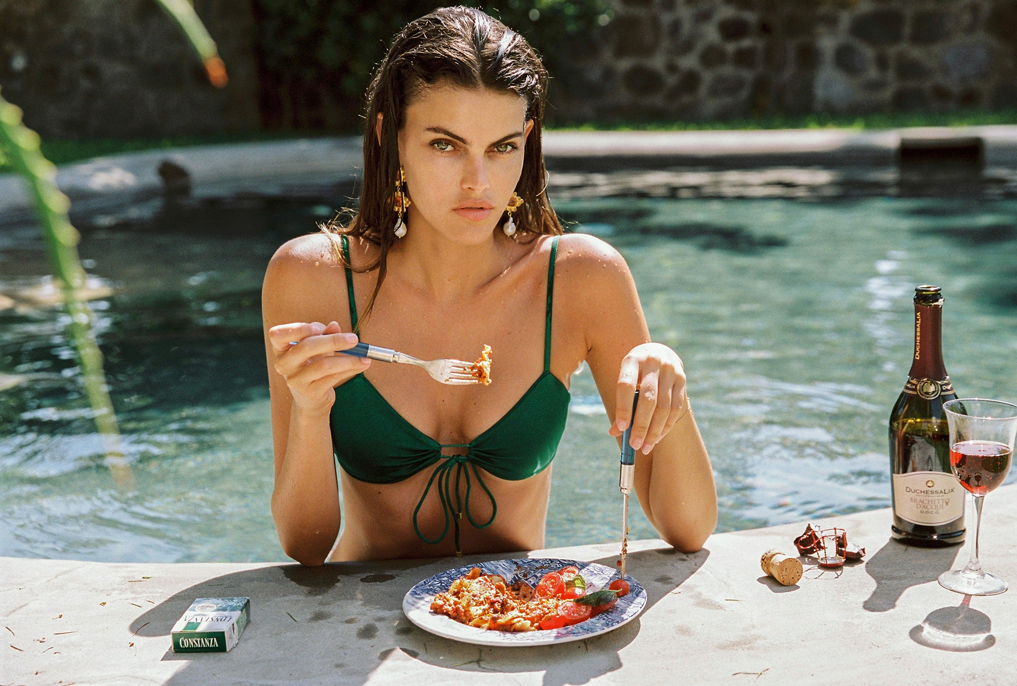 Sommer Swim model eating a bowl of homemade pasta - stay home with Sommer Swim