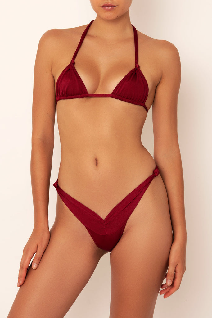 red knot bikini bottom on body