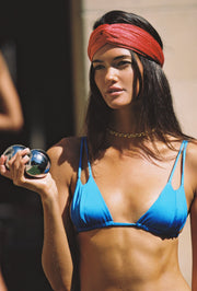 Sommer Swim model wearing Nova headband in Campari