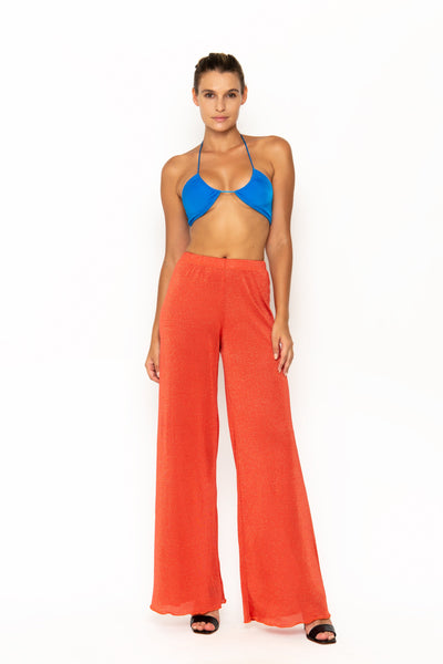 Sommer Swim model facing forward and wearing Calvi Lounge pant in Campari