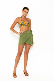 Sommer Swim model facing forwards to the left and wearing Salinas mini wrap skirt in Campari