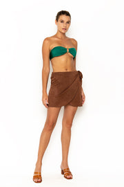 Sommer Swim model facing forwards and wearing Salinas mini wrap skirt in Cinnamon