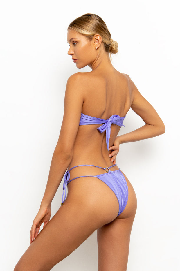 Back view of Sommer Swim model on white background wearing the Cece Bandeau Bikini Top colour Provenza