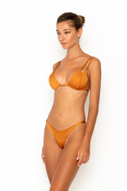 Sommer Swim model facing sideways to the right and wearing Rocha cheeky bikini bottoms in Papagayo
