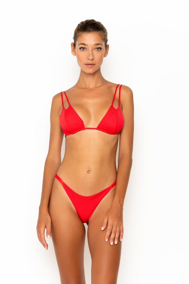 Sommer Swim model facing forwards and wearing Rocha cheeky bikini bottoms in Venere