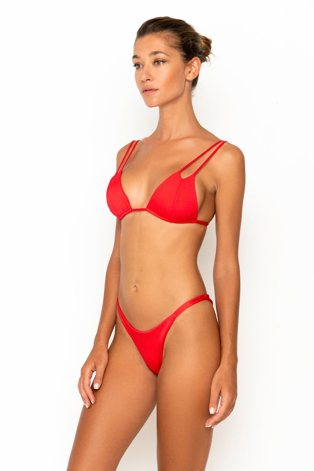 Sommer Swim model facing sideways to the right and wearing Rocha cheeky bikini bottoms in Venere
