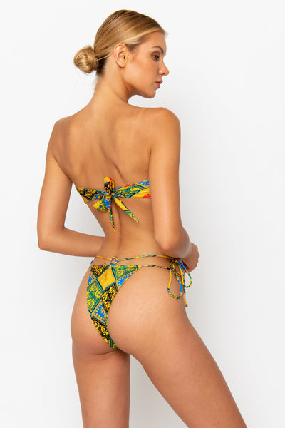 Sommer Swim model facing backwards and wearing a Dulce brazilian cut bikini bottom in Baroque