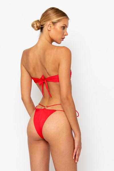 Sommer Swim model facing backwards and wearing a Dulce brazilian cut bikini bottom in Venere