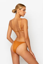 Sommer Swim model facing backwards and wearing a Eden cheeky bikini bottom in Papagayo