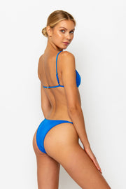 Sommer Swim model facing backwards and wearing a Eden cheeky bikini bottom in Sirius