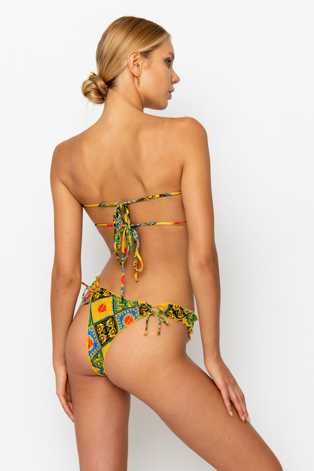 Sommer Swim model facing backwards and wearing a Josephine brazilian bikini bottom in Baroque
