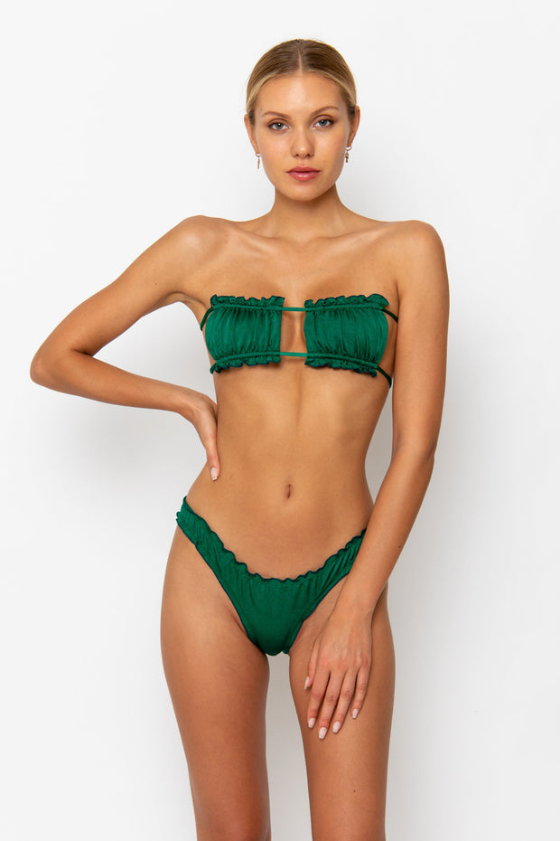 Sommer Swim model facing forwards and wearing a Josephine brazilian bikini bottom in Emerald