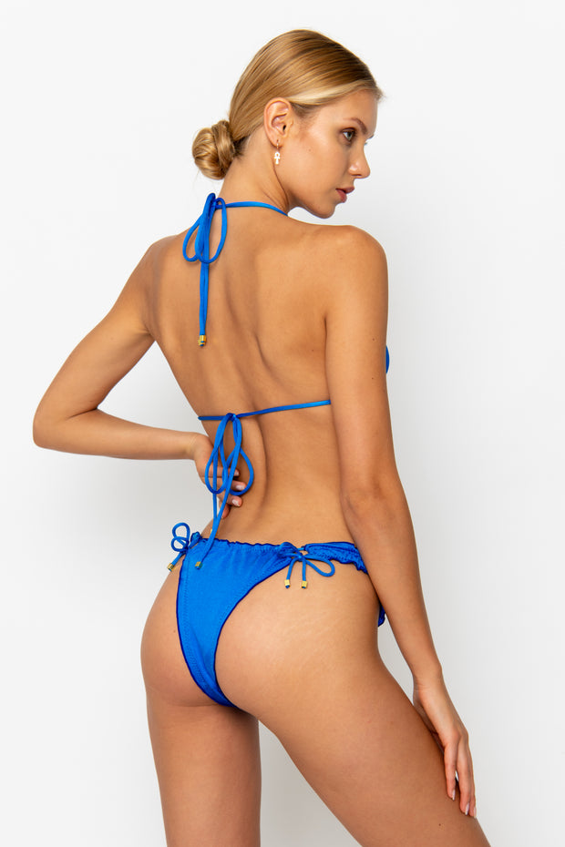 Sommer Swim model facing backwards and wearing a Josephine brazilian bikini bottom in Sirius