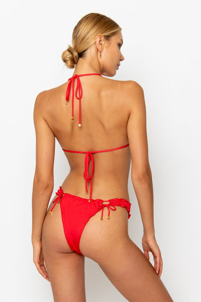 Sommer Swim model facing backwards and wearing a Josephine brazlilian bikini bottom in Venere