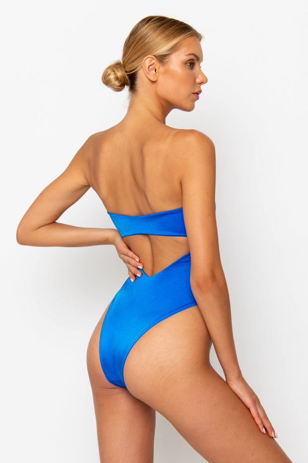 Sommer Swim model facing backwards and wearing a high cut Maxim One Piece swimsuit in Sirius