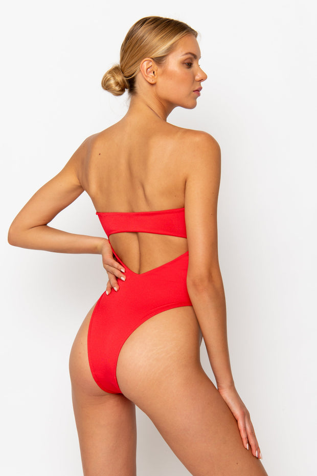 Sommer Swim model facing backwards and wearing a high cut Maxim One Piece swimsuit in Venere