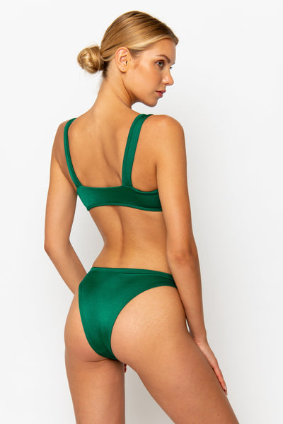 Sommer Swim model facing backwards and wearing a Maya high leg bikini bottom in Emerald