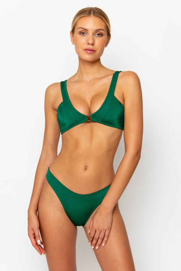Sommer Swim model facing forwards and wearing a Maya high leg bikini bottom in Emerald