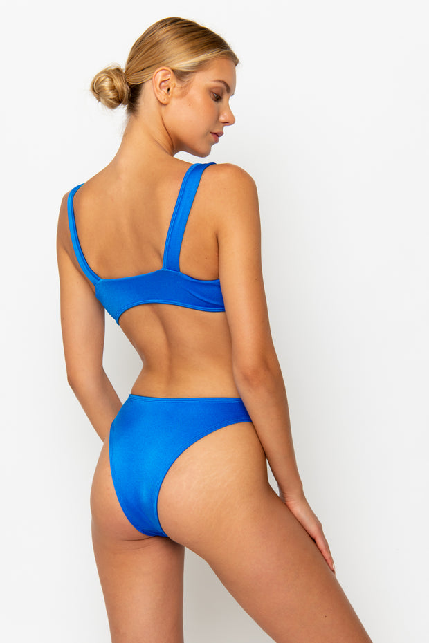 Sommer Swim model facing backwards and wearing a Maya high leg bikini bottom in Sirius