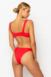 Sommer Swim model facing backwards and wearing a Maya high leg bikini bottom in Venere