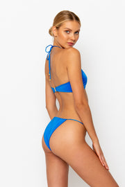 Sommer Swim model facing backwards to the right and wearing a Naomi tie side bikini bottom in Sirius