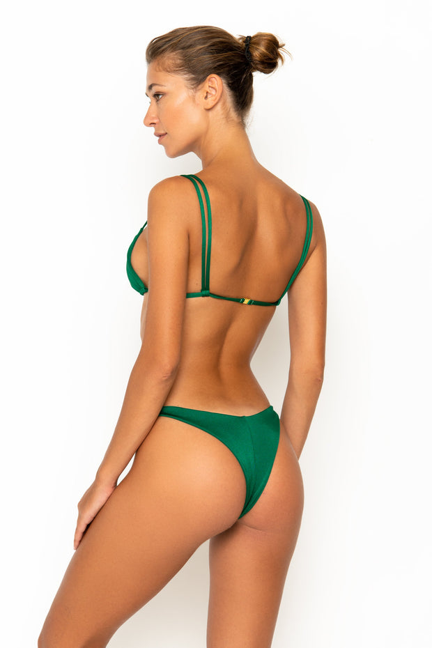 Sommer Swim model facing backwards and wearing Daria bralette bikini top in Emerald