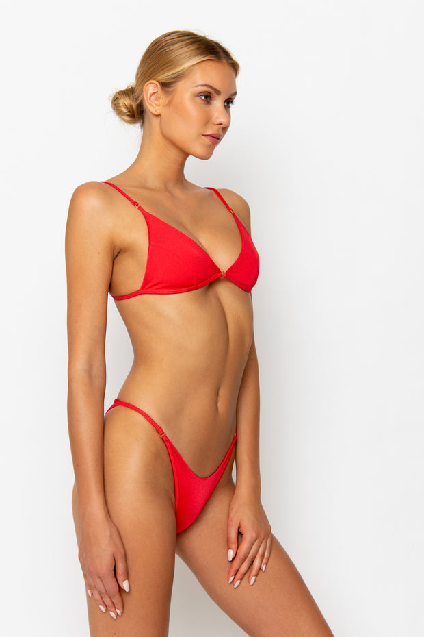 Sommer Swim model facing sideways towards the left and wearing Uma bralette bikini top in Venere