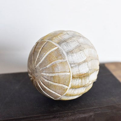 Carved wood ball/white lines