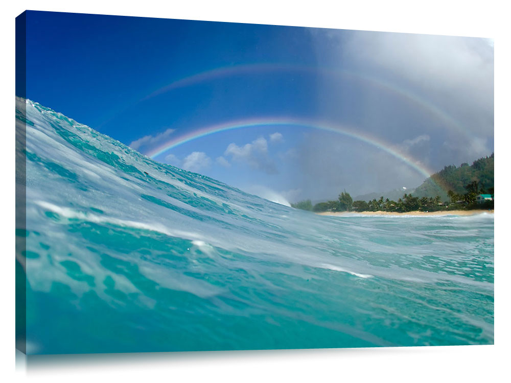 A rainbow over the surf at Pupukea, on the north shore of Oahu, Hawaii