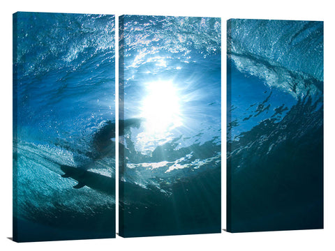 underwater view of surfing at Off The Wall, on Oahu's Nth shore.