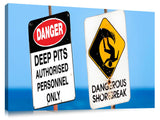 Dangerous surf warning signs at Pipeline on oahu's north shore.