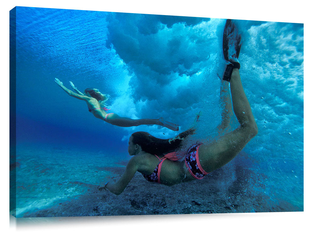 underwater view of girls swimming in the surf, north shore, Oahu