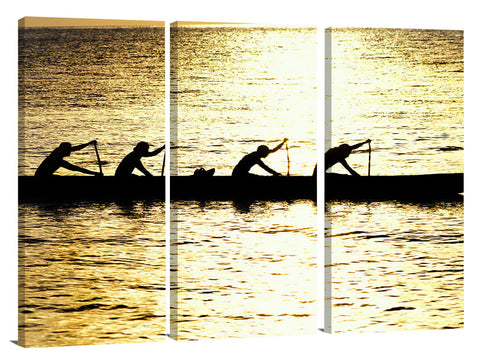Hawaiian outrigger canoe silhouetted on a golden sea, north shor